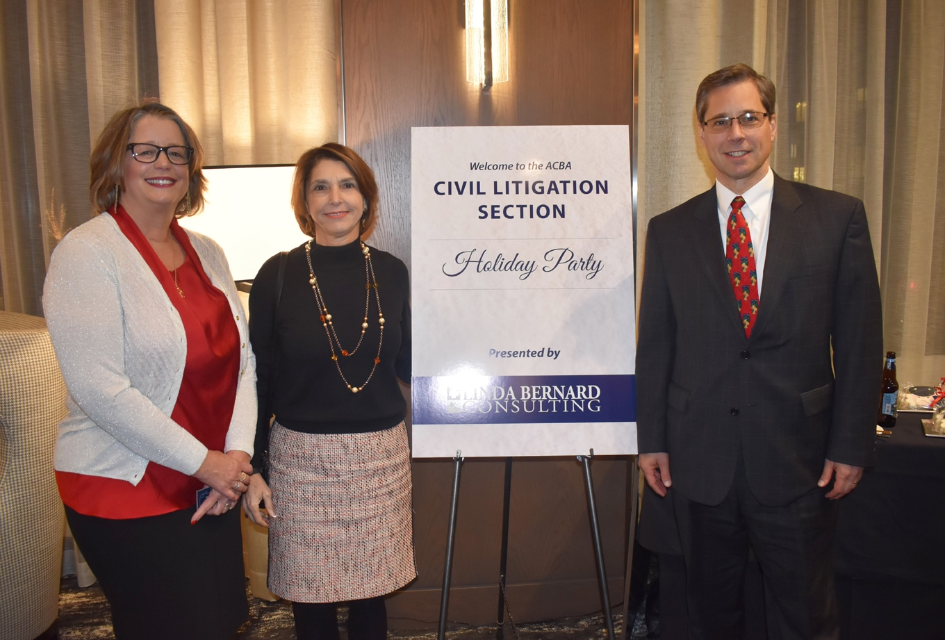 Linda Bernard, Judge Lisa Pupo Lenihan, Magistrate Judge Western District of PA, and John K. Gisleson, Partner at Morgan Lewis at the Allegheny County Bar Association Civil Litigation Holiday Party.